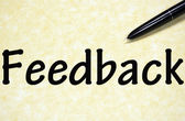 Feedback title written with pen on paper — Foto Stock
