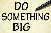 Do something big title written with pen on paper — Stock fotografie