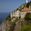 Overview of the town of Maratea with the statue of Christ in the — Stock Photo