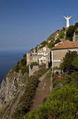 Overview of the town of Maratea with the statue of Christ in the — Stockfoto