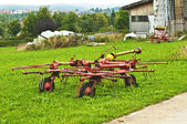 Old hay turning machine — Stock Photo