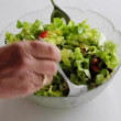 Stock Video: Mixing salad