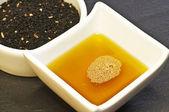 Black cumin seeds and black cumin oil — Stock Photo
