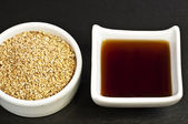 Sesame oil and sesame — Stock Photo