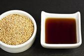 Sesame oil and sesame — Stock Photo