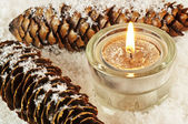 Candle in snow — Stock Photo