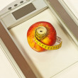 Bathroom scales with measure and apple — Stock Photo #17983689