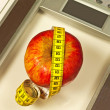 Bathroom scales with measure and apple — Stock Photo