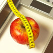 Bathroom scales with measure and apple — Stock Photo #17983723