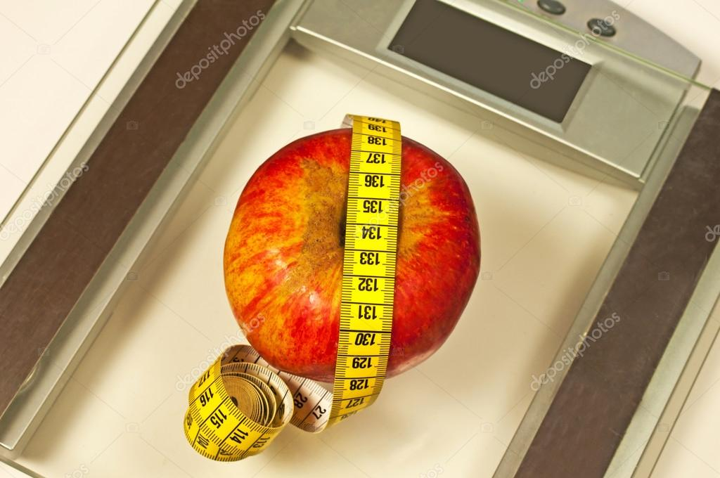 Bathroom scales with measure and apple  Stock Photo #17983715