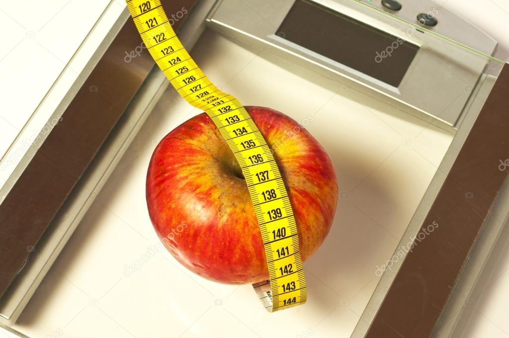 Bathroom scales with measure and apple  Stock Photo #17983723