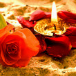 Stock Photo: Tea-light with rose on beach