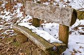 Park bench in snow — Stock Photo