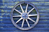 Blue wall with blue cart wheel — Stock Photo