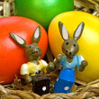 Easter basket with painted eggs and bunnies — Stock Photo