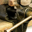 Bench vise with twisted nail — Stock Photo