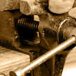 Bench vise with twisted nail — Stock Photo #23456254