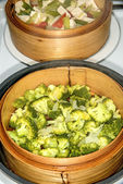 Chinese steam basket with green kale — Stock Photo