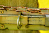 Rusty chain with lock — Stock Photo