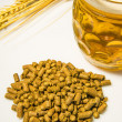 Hops pellets with beer glass — Stock Photo #33104209