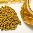 Hops pellets with beer glass — Stock Photo #33104271