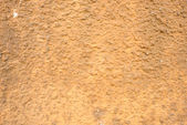Wall of concrete with brown coating — Stock Photo