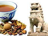 Chinese herbal medicine with temple lion — Stock Photo