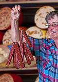 Butcher shop in Germany with female seller — Stock Photo