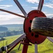 Panoramic view through a hay turning machine — Stock Photo