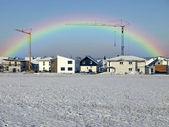 Construction field with rainbow — Stock Photo