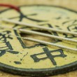 Acupuncture needles with antique chinese coin — Stock Photo