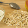 Oat flakes with milk and apple — Stock Photo