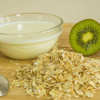 Oat flakes with milk and kiwi — Stock Photo
