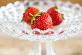 Strawberries in a glass bowl — Stock Photo