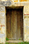 Old,medieval wall with door — Stock Photo