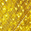 Texture yellow lamps garlands — Stock Photo
