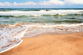 Part of the beach with the sand, the sea and the waves — Stock Photo