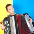 Young boy playing a  accordion - Stock Photo