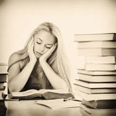 Vintage photo of Young adult caucasian woman with books — Stock Photo