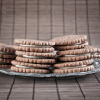Chocolate cookies filled with white cream - Stock Photo