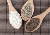Various spices in wooden spoons — Stock Photo