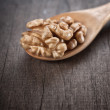 Walnut in wooden spoon — ストック写真