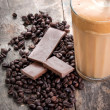 Raw coffee beans and chocolate — Stock Photo