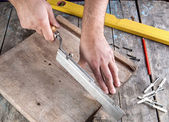 Carpenter working on a hand saw — Foto de Stock