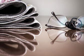 Pile of newspaper & glasses — Stock Photo