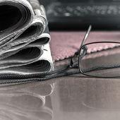 Pile of newspaper & glasses — Zdjęcie stockowe