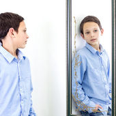 In front of mirror — Stock Photo