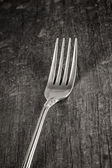 Single fork on old wooden plank — Stock Photo