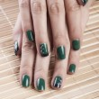 Stock Photo: Green nail polish