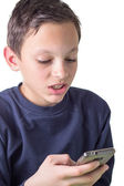 Young boy using a smartphone. — Stockfoto